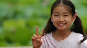 girl peace sign 787078831_afafac071f_o 300x165